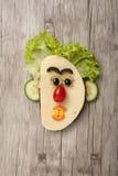 Διασκεδάζοντας πρόσωπο σάντουιτς Στοκ Εικόνα