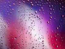 Διαστημικό ουράνιο τόξο γυαλιού βροχής υποβάθρου χρώματος πτώσεων νερού Στοκ Εικόνα