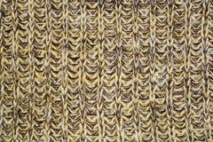 Διαστισμένη κάθετη σύσταση του κίτρινου καφετιού πλεκτού υφάσματος μαλλιού Στοκ Εικόνα