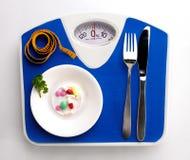 Διατροφή ακόμα με την κλίμακα Στοκ Εικόνες
