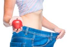 Διατροφή της Apple στη δράση, εστίαση στο μήλο υπό εξέταση Στοκ εικόνα με δικαίωμα ελεύθερης χρήσης