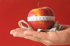 Διατροφή Apple και μετρητής σε ετοιμότητα Στοκ εικόνα με δικαίωμα ελεύθερης χρήσης