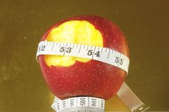 Διατροφή Apple και μετρητής Στοκ Φωτογραφία