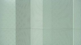 Διατρυπημένος αργίλιο τοίχος στοκ εικόνα με δικαίωμα ελεύθερης χρήσης