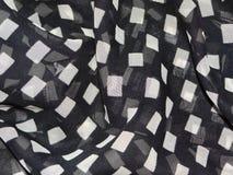Διαφανές μαύρο ύφασμα με τα άσπρα πλαίσια Στοκ φωτογραφία με δικαίωμα ελεύθερης χρήσης