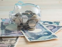 Διαφανής δείτε μέσω της piggy τράπεζας στοκ εικόνες