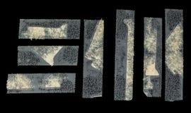 Διαφανής κολλητική ταινία Grunge στο μαύρο δέρμα faux που απομονώνεται Στοκ φωτογραφία με δικαίωμα ελεύθερης χρήσης