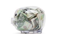 Διαφανής piggy τράπεζα με τα χρήματα στιλβωτικής ουσίας Στοκ εικόνα με δικαίωμα ελεύθερης χρήσης