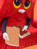 διαφημιστικό κοστούμι καναπέδων μορφής Στοκ εικόνα με δικαίωμα ελεύθερης χρήσης