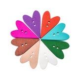 Διαφορετικά διαμορφωμένα καρδιά ράβοντας κουμπιά επιλογής χρωμάτων σε μια μορφή λουλουδιών Στοκ Εικόνες