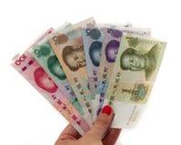Διαφορετικά κινεζικά τραπεζογραμμάτια Yuan που απομονώνονται στο λευκό στοκ φωτογραφία