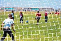 Διαφορετικά παιδιά που παίζουν το ποδόσφαιρο ποδοσφαίρου στο σχολείο Στοκ εικόνες με δικαίωμα ελεύθερης χρήσης