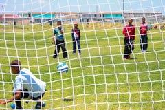 Διαφορετικά παιδιά που παίζουν το ποδόσφαιρο ποδοσφαίρου στο σχολείο Στοκ εικόνα με δικαίωμα ελεύθερης χρήσης