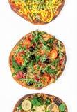 Διαφορετική vegan πίτσα τρία σε ένα άσπρο υπόβαθρο Στοκ Φωτογραφία