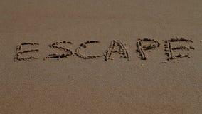 Διαφυγή, λέξη, άμμος, θάλασσα, ακτή απόθεμα βίντεο