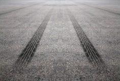 Διαδρομές ροδών στο δρόμο Στοκ Φωτογραφίες