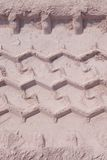 Διαδρομή ροδών που τρέχει μέσω της άμμου, που χρησιμοποιείται ως υπόβαθρο Στοκ εικόνες με δικαίωμα ελεύθερης χρήσης