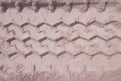Διαδρομή ροδών που τρέχει μέσω της άμμου, που χρησιμοποιείται ως υπόβαθρο Στοκ Φωτογραφία