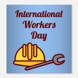 Διεθνές ευχετήρια κάρτα ή έμβλημα ημέρας εργαζομένων Τα επίπεδα εικονίδια είναι ένα προστατευτικό κράνος και ένα γαλλικό κλειδί ω στοκ φωτογραφία