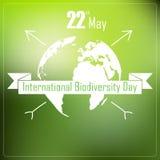 Διεθνές υπόβαθρο ημέρας βιοποικιλότητας με τη γη και την κορδέλλα μια τυπογραφία μορφής ελεύθερη απεικόνιση δικαιώματος