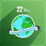 Διεθνής έννοια ημέρας βιοποικιλότητας με τη σφαίρα και την κορδέλλα στο πράσινο υπόβαθρο απεικόνιση αποθεμάτων