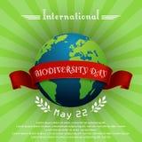 Διεθνής έννοια ημέρας βιοποικιλότητας με τη σφαίρα και την κόκκινη κορδέλλα απεικόνιση αποθεμάτων