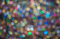 Διεσπαρμένο πολύχρωμο ακτινοβολώντας bokeh υπόβαθρο Στοκ Φωτογραφία