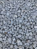 Διεσπαρμένο υπόβαθρο πετρών επίστρωσης πετρών τυχαία Στοκ φωτογραφία με δικαίωμα ελεύθερης χρήσης