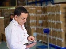 Διευθυντής στην αποθήκη εμπορευμάτων Στοκ Εικόνα