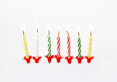 Διευκρινισμένα καίγοντας κεριά γενεθλίων Στοκ Φωτογραφία