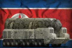 Διηπειρωτικός βαλλιστικός πύραυλος με την κάλυψη πόλεων στο δημοκρατικό BA εθνικών σημαιών Βόρεια Κορεών Δημοκρατίας λαών της Κορ Στοκ φωτογραφία με δικαίωμα ελεύθερης χρήσης