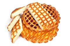 Δικτυωτό πλέγμα διάφορων πιτών με το τυρί, τη μαρμελάδα και το λεμόνι επάνω Στοκ Εικόνα