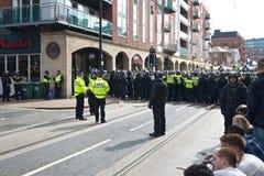 Διοικητές αστυνομίας και κορδόνι αστυνομίας Στοκ Φωτογραφίες