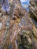 Διπλωμένοι βράχοι με τις μπότες Στοκ Εικόνες