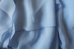 Διπλωμένο λεπτό ανοικτό μπλε ύφασμα σιφόν Στοκ φωτογραφία με δικαίωμα ελεύθερης χρήσης