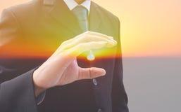 Διπλός επιχειρηματίας έκθεσης και ο ήλιος Στοκ Φωτογραφίες