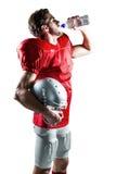 Διψασμένος φορέας αμερικανικού ποδοσφαίρου στο κόκκινο πόσιμο νερό του Τζέρσεϋ Στοκ εικόνες με δικαίωμα ελεύθερης χρήσης
