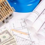 Δολάριο νομισμάτων, ηλεκτρικά διαγράμματα, εξαρτήματα για τις εργασίες μηχανικών και σπίτι κάτω από την κατασκευή, έννοια εγχώριω Στοκ Εικόνες