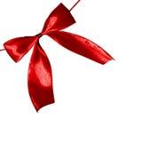 Δονούμενο τόξο σατέν διακοπών κόκκινου χρώματος δώρων Chrismas Στοκ Φωτογραφία