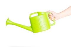 Δοχείο ποτίσματος εκμετάλλευσης χεριών Στοκ φωτογραφία με δικαίωμα ελεύθερης χρήσης