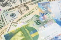 Δολάρια και ελβετικά φράγκα Στοκ Φωτογραφίες