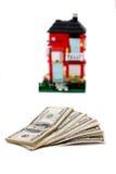 Δολάρια και σπίτι Στοκ Φωτογραφία