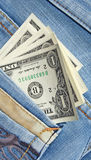 Δολάρια στην τσέπη τζιν Στοκ Φωτογραφία