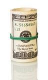 Δολάρια στο ρόλο που στερεώνεται το λάστιχο που απομονώνεται από στο λευκό στοκ εικόνες