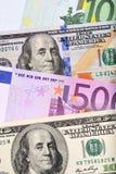 Δολάριο και ευρο- τραπεζογραμμάτια στον πίνακα Στοκ Εικόνες