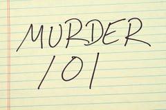 Δολοφονία 101 σε ένα κίτρινο νομικό μαξιλάρι Στοκ Εικόνες