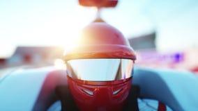 Δρομέας του τύπου 1 σε ένα αγωνιστικό αυτοκίνητο Έννοια φυλών και κινήτρου Ηλιοβασίλεμα Wonderfull Ρεαλιστική 4K ζωτικότητα απεικόνιση αποθεμάτων