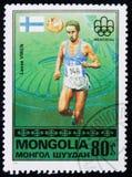 Δρομέας Lasse Liren της Φινλανδίας, από τους Ολυμπιακούς Αγώνες σειράς `, Μόντρεαλ - νικητές `, circa 1976 χρυσών μεταλλίων Στοκ εικόνες με δικαίωμα ελεύθερης χρήσης
