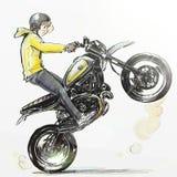 Δροσερό αγόρι που οδηγά την ακραία μοτοσικλέτα Στοκ Εικόνα