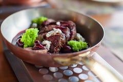 Δροσερό κρέας στη σάλτσα κερασιών Στοκ Εικόνες